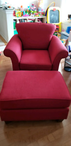 Red armchair with foot stool