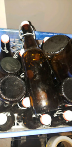 7.5 dozen flip top beer bottles