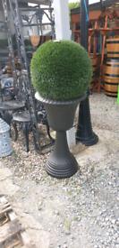Artificial outdoor tree in urn.