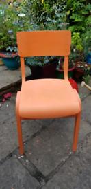 Old wooden school chair. Painted in rustoleum pumpkin.
