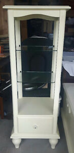 off white glass shelving unit with glass shelves and drawer
