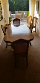 Mahogany extendable dining room table and 6 chairs.