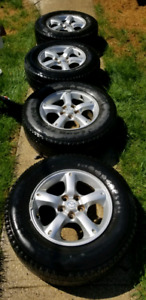4x Mazda rims (5x114.3) and tires.