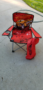 Two kids folding chairs