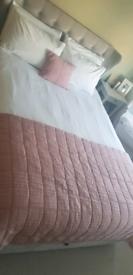 Pink Laura Ashley bedspread and cushion