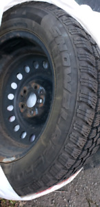Four 215/60  17 inch Winter Tires on rims