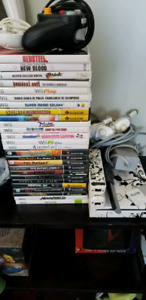 NINTENDO Wii with Wii FiT board, many games and accessories