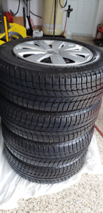 Michelin X-ice 215/60r16 Tires on VW Rims w/Wheel Covers