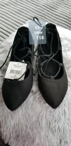 Pair of black suede shoes with tags sz 7
