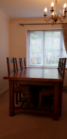 Solid oak dining table, chairs and matching dresser