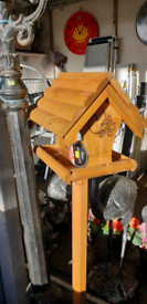 Wooden wild bird tables and dovecote