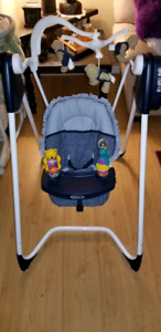 Graco Swing with 15 songs, 6 speeds and a timer!