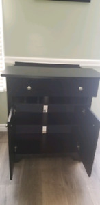 Black cabinet with built in charging station