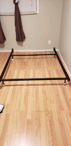 Double metal bed frame on wheels