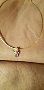 Omega gold chain and slider pendant.