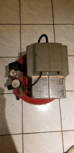 Portable  air compressor on wheels. Best offer takes it home