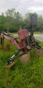 2006 Backhoe for a tractor may also trade