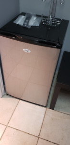 Stainless refrigerator perfect for office or dorm..