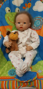 Reborn Doll and baby chair.