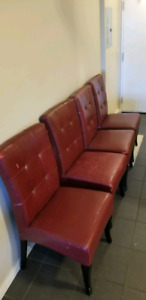 4 red faux leather chairs