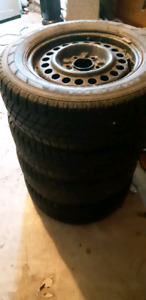 Set of 4 15 inch 5 bolt winter tires on rims