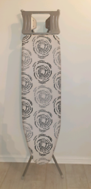 Like new foldable Ironing Board With cover