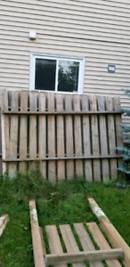 Stained wooden fence sections