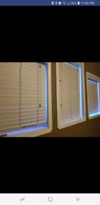 White composite wood style blinds.