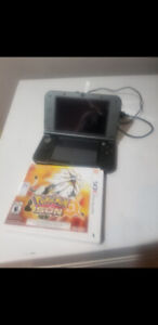 Nintendo 3ds for sale comes with pokemon sun barley used