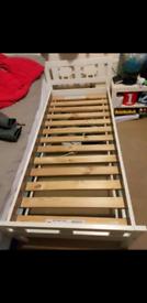 Bed frame with slanted bed base for kids.