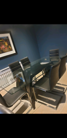 Price reduced- Large glass dining table and chairs