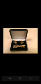 Tennis matching tie clip and cuff links. Brand new never been used.
