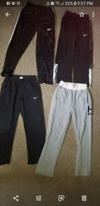 Boys pants size medium and large Nike and Tommy Hilfiger