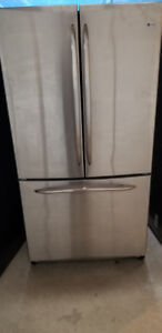 GE Stainless French Door Refrigerator, with Water and Ice.