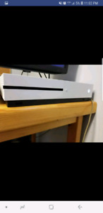 Xbox one s. 1tb and 11 games 2 controllers. Excellent condition