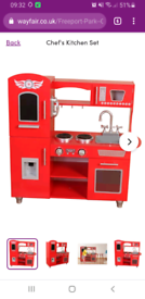 Red kitchen toy and comes with red accessories