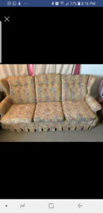 A beautiful antique couch with a nice pattern.