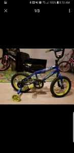 "Boys 14"" huffy bike with training wheels"