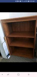 Brown wooden shelving unit