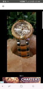 Rose gold and silver guess watch
