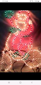 Christmas concept rope light santa on bicycle