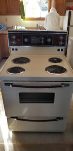 Kenmore kitchen stove almond colour.