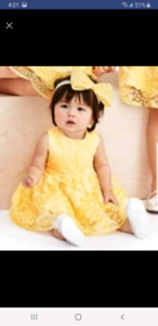 Yellow lace baby dress with matching bow