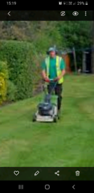 Gardener. Tree surgeon. bushes trimming.Grass cutting