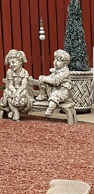 girl and boy on a seat statue