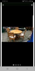 Compact round dining table and chairs