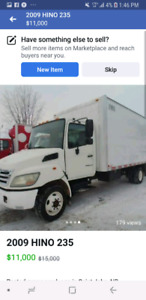 2007  Hino 235 diesel with hydraulic hydraulic lift.