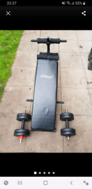 Exercise sit up bench with dumbbells