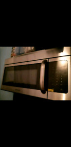 NEW Frigidaire over-the-range microwave stainless 1.7 cu. Ft