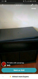 TV table with swivel top and storage